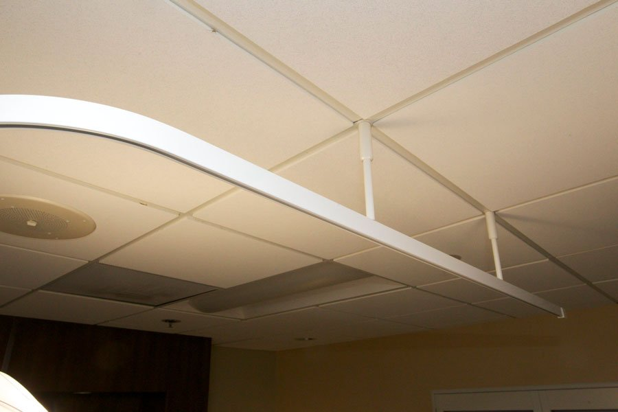 Rapid Rail curtain rail system saves on wear and tear costs as well as potential injuries to workers.
