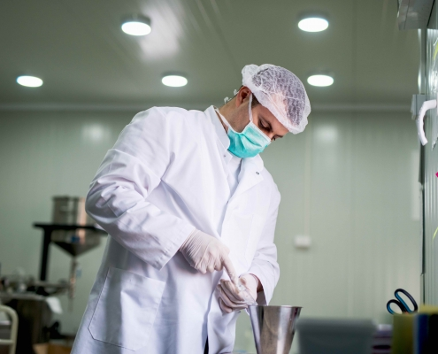 Protective worker at pharmaceutical factory on his work place.